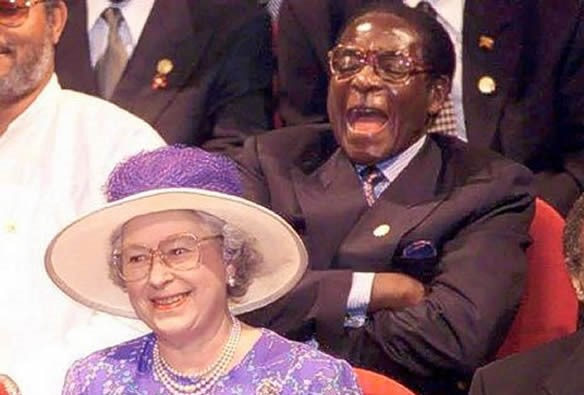 mugabe-laughs-behind-the-queen-590