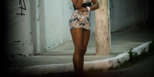 A prostitute stands along a street in Fortaleza, Ceara State, northeastern Brazil, on April 16, 2013. AFP PHOTO/Yasuyoshi CHIBA        (Photo credit should read YASUYOSHI CHIBA/AFP/Getty Images)
